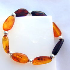 A bracelet from natural amber (traces of prehistoric plants) with silver balls.