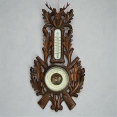 Dutch holosteric hunting barometer on hand-carved wooden plate