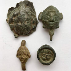 A selection of Four Roman Bronze Heads Facing / 15 - 28mm (4)