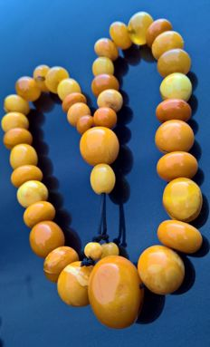 Antique, collectible egg yolk Amber necklace,  38 grams.