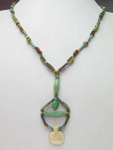 Egyptian necklace of faience beads and shells solar disk amulet - 52 cm