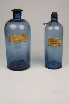 Two antique blue glass pharmacy jars