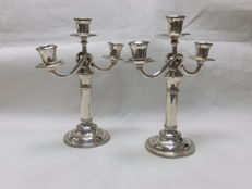 Pair of silver candelabra for three candles. Spain. 19th Century.