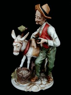 Capodimonte Porcelain Figurine of man with donkey