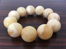 Baltic Amber bracelet, white egg yolk colour, 42 grams, beads 21 mm with marble effect