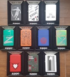 "Collection of 10 Limited Edition ""Find the Hidden Z"" Zippo lighters in original box with pappers"