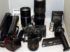 Lot of Olympus lenses, winder and compact
