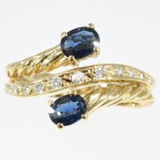 18K yellow gold ring with two sapphires and 12 brilliant cut diamonds