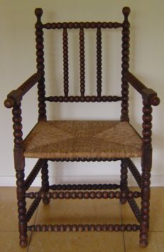 Old Dutch buttons or beads chair with rush seating, early 20th century
