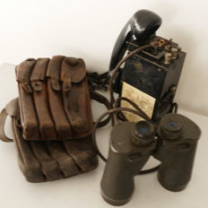 Lot of binoculars, phone and two bags from WW2.