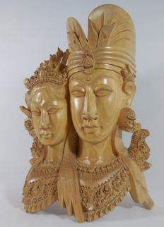 Woodcarving of a traditional dancing couple - Bali - Indonesia
