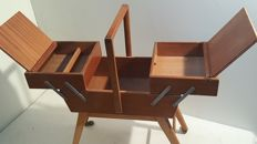 Wooden trolley with folding retractable tailor tool holders.