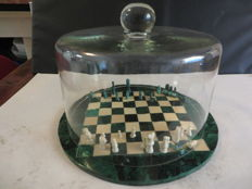 Chess set made of malachite with glass bell