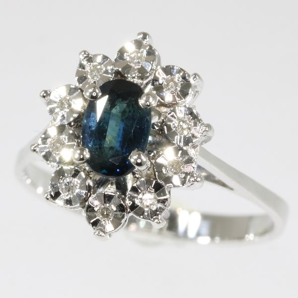 white gold ring embellished with sapphire