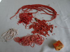 Collection of separate precious corals and pieces of precious coral, white and pink coral and a block of coral