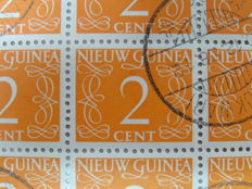 Dutch New Guinea and Suriname 1948/1962 - Batch of sheet parts in 4 old folders
