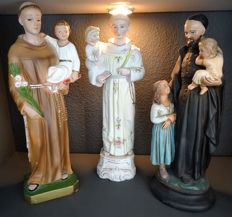Three large statued of Anthony of Padua with baby Jesus