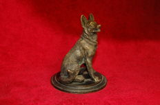 Statuette of a german shepherd on a stand