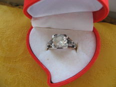 14K gold and platinum ring with 4 round cut diamonds and one massive round cut White Sapphire