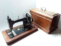 Antique sewing machine original Victoria, England, first half 20th century