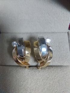 18 kt Yellow and white gold. Earring with zirconia Measurements 14x9 mm