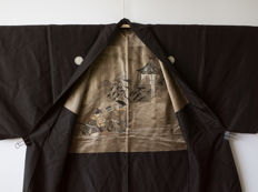Black silk haori. Decorated with a samurai and his helper on the partially embroidered silk lining – Japan – circa 1950