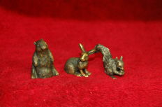 Three miniature bronze rodents (squirrel, marmot, rabbit or hare)