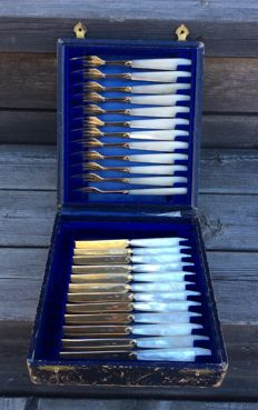 Set of 12 gilded silver knives and 12 gilded silver forks with mother of pearl handles in original box, France, Paris, after 1838