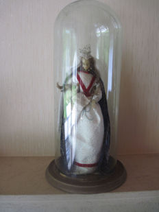 Mary devotion under authentic bell jar.