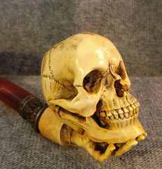 Resin pipe, a skull on a hand - Austria, Vienna - 1970s/80s