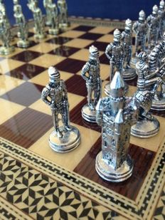 The Reconquest chess made of bronze on marquetry board