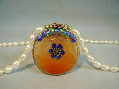 Pearl necklace with carnelian disc and multicoloured enamel