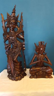 Twee statues of a Legong dancer and a priest - Bali - Indonesia