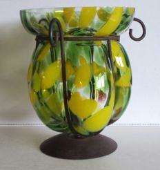 Blown glass vase in wrought iron frame
