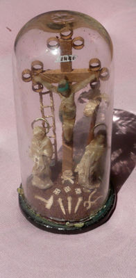 Antique reliquary under bell jar: Jesus on the cross with saints