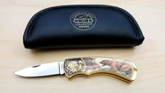 Franklin Mint collectors' knife with  porcelain inlay of a bear.