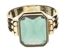 Yellow gold ring set with a synthetic green stone, probably a synthetic emerald
