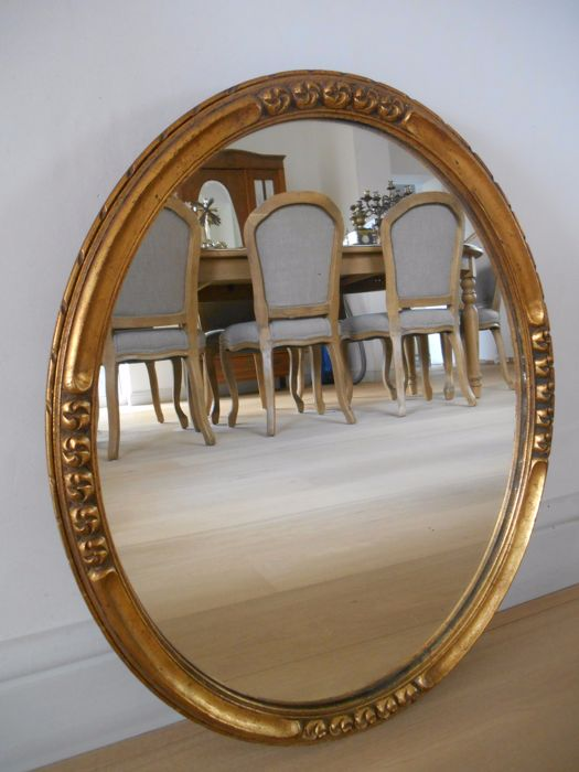 Gilt wooden oval mirror