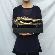 Crocodile skull made of bronze mounted on stand - length 37 cm