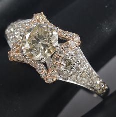 0.82 ct. Center Solitaire diamond ring with Side diamonds of 0.49 ct. -Total diamond weight 1.31 ct