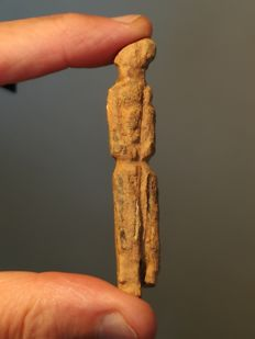 Bronze Age  fossilized bone female idol    –  78 x 14 mm