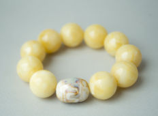 Baltic amber bracelet with faience bead white/yellow color, 36 gram