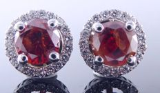 White gold 18 kt, stud earrings set with intense, fancy, deep red colour diamonds of 1.40 ct in total.