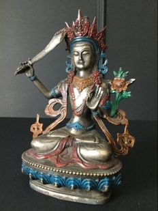 Representation of the Bodhisattva Manjushri in silvered and painted copper - Nepal - 1985
