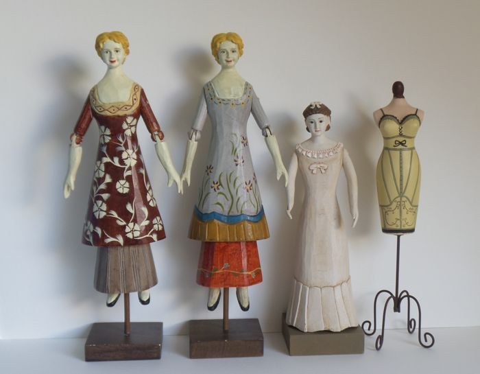 Four hand-carved and hand-painted dolls