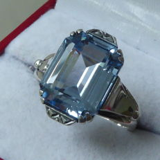 A silver ring with light blue topaz in Art Deco style