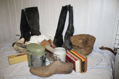Former attic Fund of a German soldier from WW2, helmets, boots,