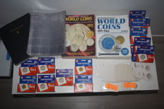 "Coin album, 40 separate sheets, 310 coin holders and 2 x standard Krause World coin catalogue ""World coins"" 1901-1999 and 2001-2012"