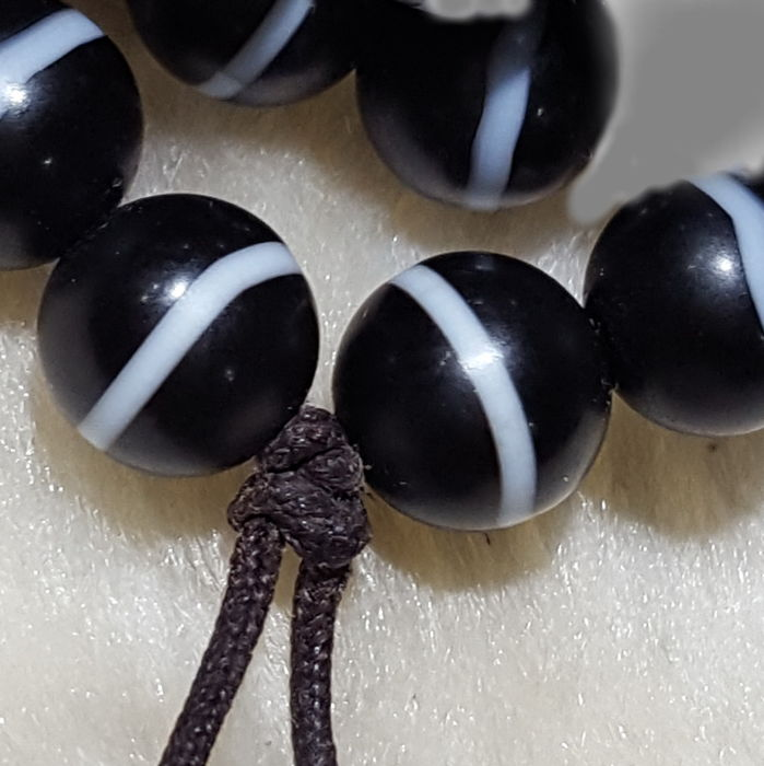 A group of six Scottish banded agate beads