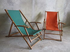 Designer unknown – 2 vintage folding deckchairs.